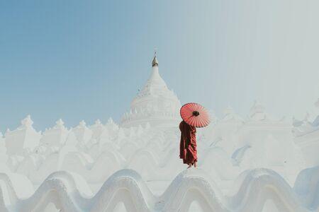 Monk standing on white temple Stok Fotoğraf