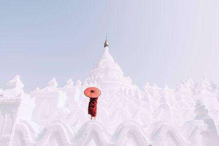 Monk standing on white temple Stock fotó
