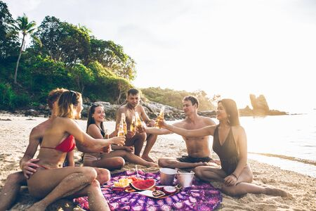 Group of friends having fun on the beach on a lonely island Stock Photo