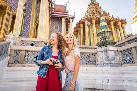 Beautiful women visiting Bangkok attractions and landmarks in Thailand