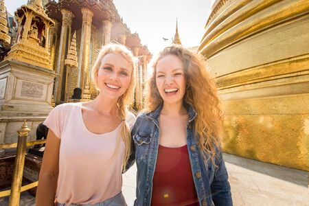 Beautiful women visiting Bangkok attractions and landmarks in Thailand