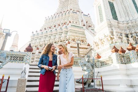 Beautiful women visiting Bangkok attractions and landmarks in Thailand - Young happy tourists exploring a south-east asian city Archivio Fotografico
