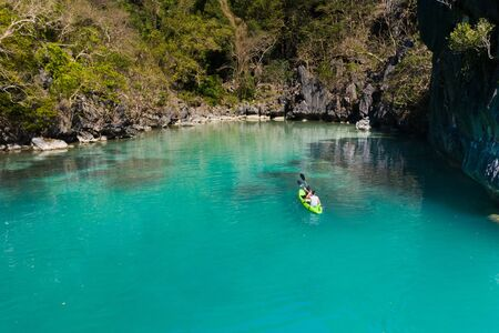 Couple kayaking on Tropical Island with blue water Reklamní fotografie