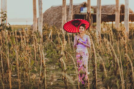 Southeast Asian young girls with burmese traditional dress outdoors, Mandalay