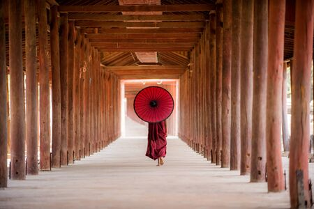 Novice buddhist monks with traditional dress in  a temple