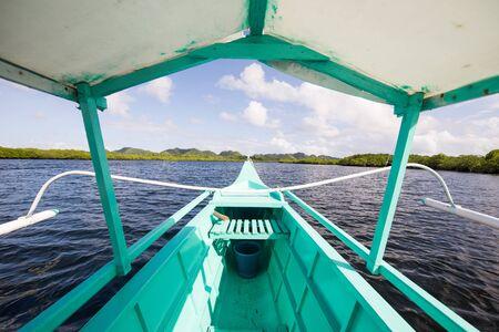 Boat navigating through Sugba lagoon. Beautiful landscape with blue sea lagoon, National Park, Siargao Island, Philippines