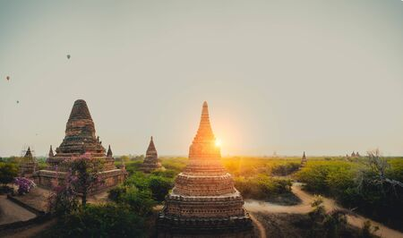 Scenic sunrise with many hot air balloons above Bagan in Myanmar. Bagan is an ancient city with thousands of historic buddhist temples and stupas