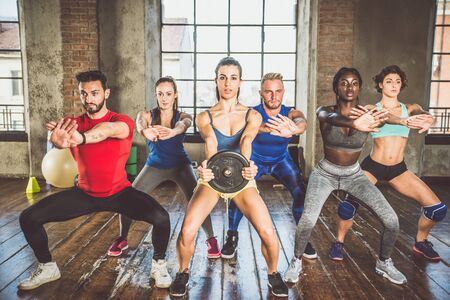 Mixed race group of athlete at the gym Stock Photo