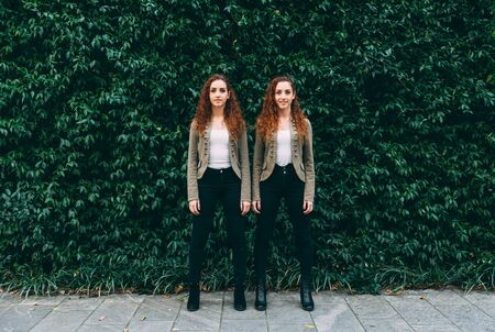 Two twins sisters spending time together