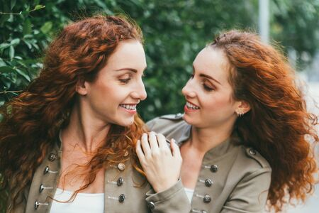 Two twins sisters spending time together Stock Photo