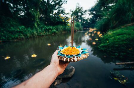 Loy krathong festival, thai new year party with floating buckets release in the river