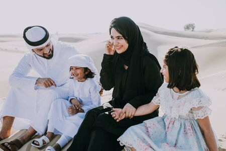 Happy family spending a wonderful day in the desert