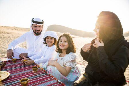 Happy family spending a wonderful day in the desert making a picnic Reklamní fotografie