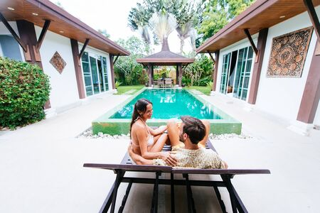 Happy couple spending time in a beautiful vacation house