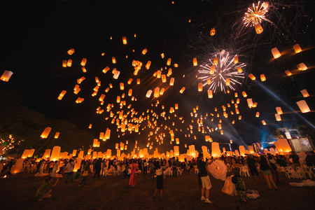 Loy krathong festival, thai new year party with floating lanterns release in the night sky