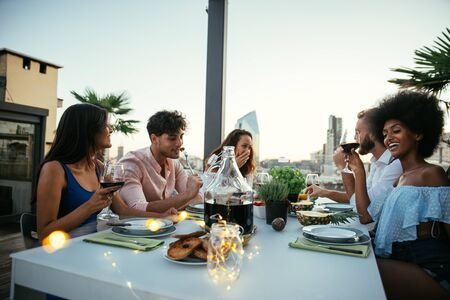 Group of friends having fun on the rooftop of a beautiful penthouse Reklamní fotografie