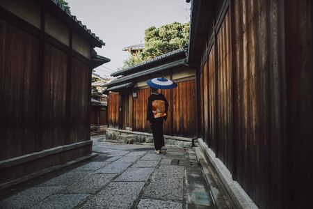 Beautiful japanese senior woman walking in the village. Typical japanese traditional lifestyle
