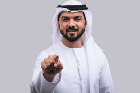 Arabic handsome man pointing studio portraits Stock Photo
