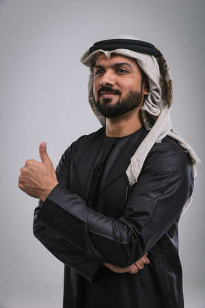 Arabic handsome man shows thumb up studio portraits