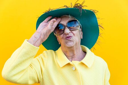 Funny grandmother portraits. Senior old woman dressing elegant for a special event. Concept about seniority