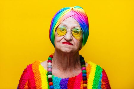 Funny grandmother portraits.granny fashion model on colored backgrounds Standard-Bild - 132081457