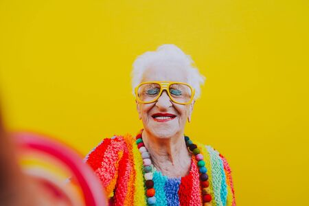 Funny grandmother portraits.granny fashion model on colored backgrounds Standard-Bild - 132081390