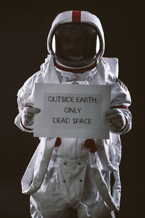 Astronaut leaving earth. Searching for a new home for humanity. Concept about science and nature. showing a message Reklamní fotografie