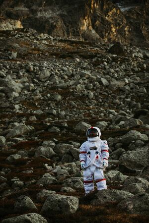 Astronaut exploring a new planet. Searching for a new home for humanity. Concept about science and nature