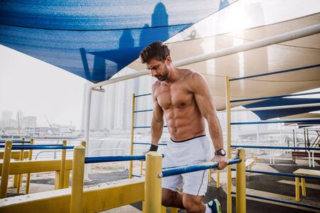 man doing work out and different exercises outdoor Stock Photo