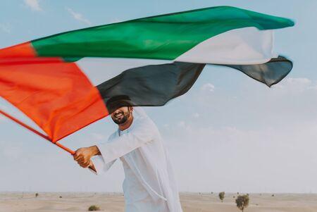 business men wearing traditional uae white kandura spending time in the desert of Dubai