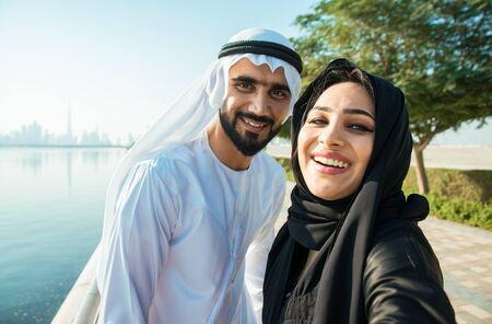 Happy couple walking in Dubai. Man and woman going out for shopping. Concept about relationship in the uae Stock Photo