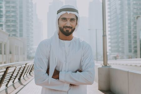 Beautiful middle eastern man wearing kandora traditional outfit in Dubai. Portraits in the emirates