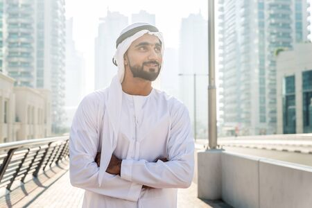Beautiful middle eastern man wearing kandora traditional outfit in Dubai. Portraits in the emirates Stock fotó - 137878441