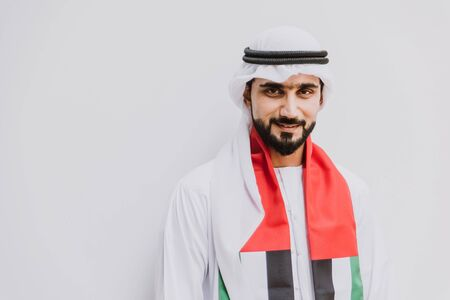 Beautiful middle eastern man wearing kandora traditional outfit in Dubai. Portraits in the emirates Stock fotó - 137878618