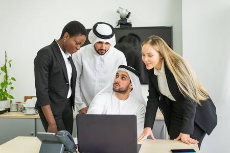 Multiracial group of business people having a meeting in a office - Teamwork in the office, business meeting in the UAE Reklamní fotografie