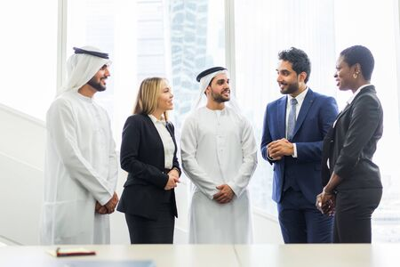 Multiracial group of business people having a meeting in a office - Teamwork in the office, business meeting in the UAE