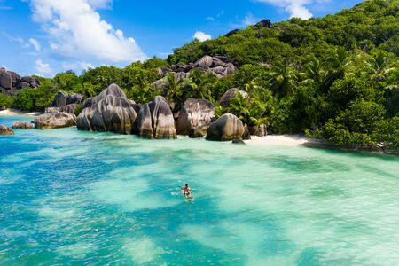 Beautiful beach with white sand on a tropical island in the Seychelles - The famous beach of Anse d'Argent in La Digue