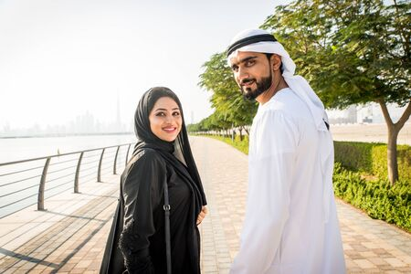 Beautiful middle eastern couple dating outdoors in Dubai - Married pair meeting outdoors and having fun