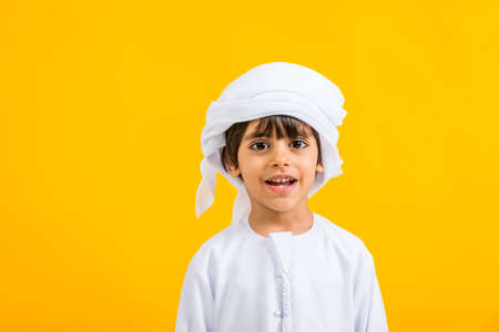 Arabian kid with traditional emirates dress
