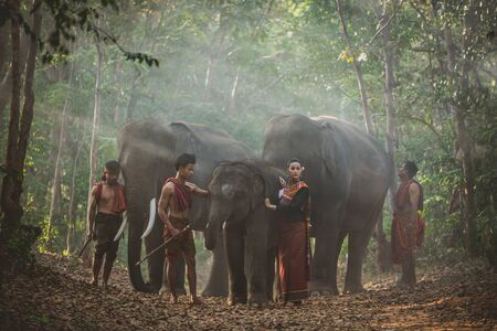 Group of thai shepherds in the jungle with  elephants. Historic lifestyle moments from thailand culture Archivio Fotografico