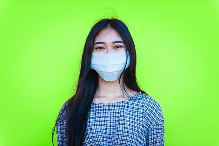 asian girl going out after quarantine during coronavirus period. Young woman outdoor with safety masks