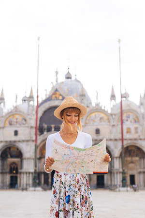 Beatiful young girl having fun while visiting Venice - Tourist travelling in Italy and sightseeing the most relevant landmarks of Venezia - Concepts about lifestyle, travel, tourism Stock Photo