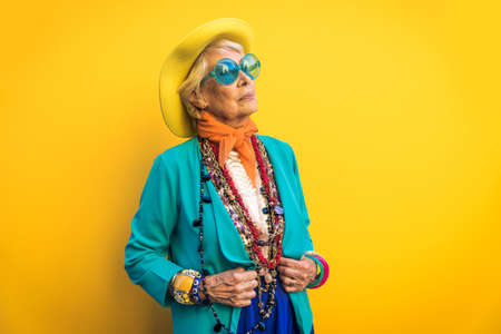 Happy and playful senior woman having fun - Portrait of a beautiful lady above 70 years old with stylish clothes, concepts about senior people Reklamní fotografie