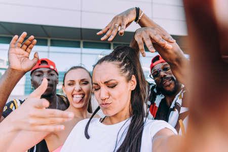 Group of hip hop dancers taking a break and shooting selfies Stok Fotoğraf