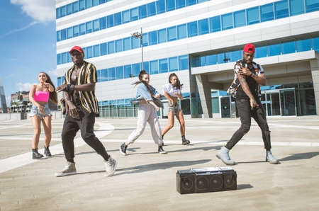 Group of hip hop dancers permorming their dance. Crew making show in an urban place Stok Fotoğraf