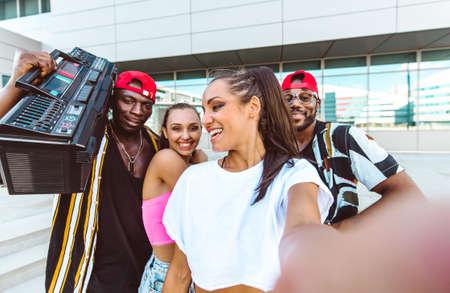 Group of hip hop dancers taking a break and shooting selfies 版權商用圖片