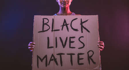 African american girl kneeling for the social movement BLACK LIVES MATTER in usa, 2020 写真素材