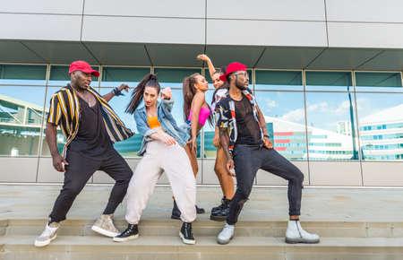 Hip hop crew dancing - Multiracial group of people having fun outdoors