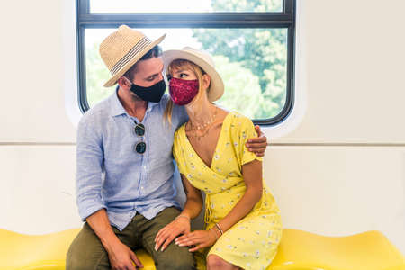 Beautiful couple driving on a subway wagon during covid-19 pandemic, concepts about lifestyle, transportation and social distancing