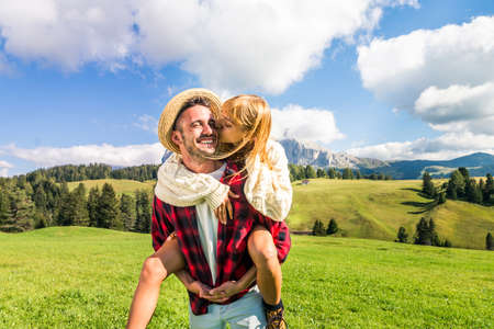 Beautiful young couple traveling in the Dolomites, Italy - Two lovers having a day trip in the nature